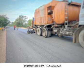 Road construction(para slurry seal), photo blurred
