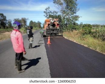 Road construction(para slurry seal), photo blurred