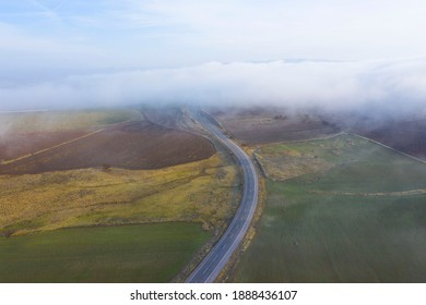 The road is covered in fog.