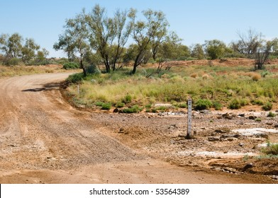 Road crossing a dry creek on the Oodnadatta Track, Australia
