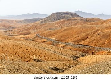 Road Crossing Volcanic Landscape in Fuertevendura, Canary Islands