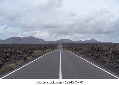 Road crossing volcanic terrain, Lanzarote Island, Canary, Spain