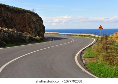Road curve in mountains over the sea