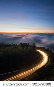 Road curve scene before sunrise