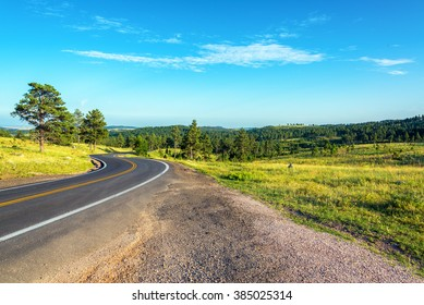 Road curving though the Black Hills National Forest in South Dakota