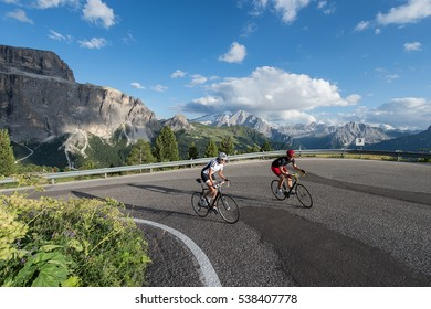 road cycling uphill on dolomite mountain pass