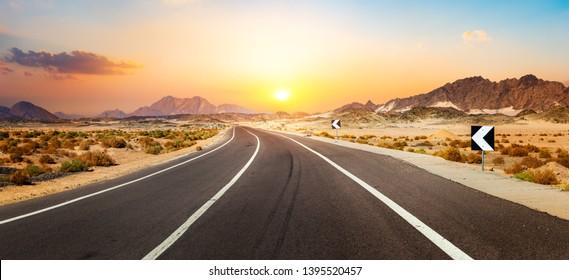Road in the desert of Egypt at sunset