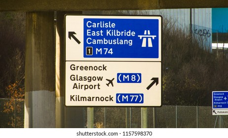 Road directional sign for Carlisle, Greenock and Glasgow Airport.