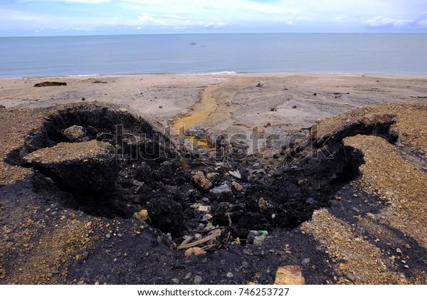Road erodes water beach erosion.