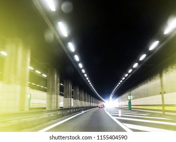 Road in Europe. Driving forward in a cool tunnel.