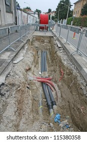 road excavation at a construction site at conduits for the laying of fibre optic and electric cable