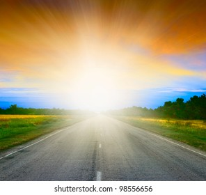 Road in field at early morning. SUnrise.