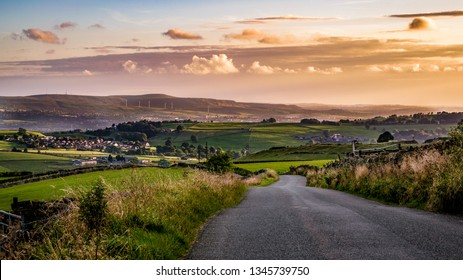 Road, Fields and moorland at South Pennines above Nelson in Lancashire, England