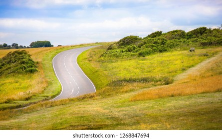 The Road Finding Its Way in the Terrain near Beachy Head, Eastbourne Downland, South Downs National Park, England