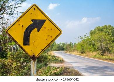 Road in the forest with traffic sign