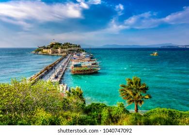 The road goes to Pigeon Island in Kusadasi. Kusadasi is a popular tourist destination in Turkey. ( HDR shot )