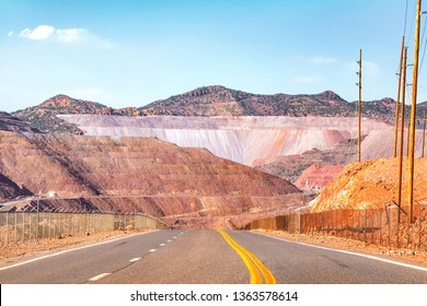 Road going through dramatic minefield landscape.