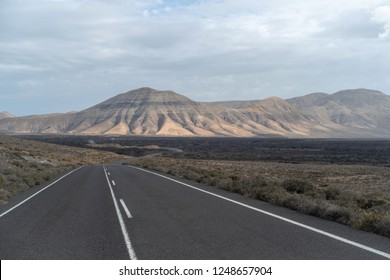 Road going through wilderness area in Lanzarote, Canary Islands, Spain