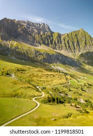 Road going toward a mountain in the french alps near the Col des Aravis.