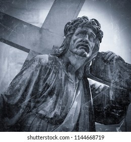 The road to Golgotha. Ancient statue of Jesus Christ with cross. Retro styled.