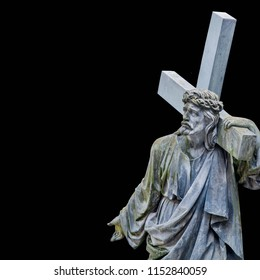 The road to Golgotha. Ancient statue of Jesus Christ with cross. (holy, faith, religion, God, suffering concept)