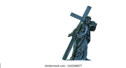 The road to Golgotha. Ancient statue of Jesus Christ with cross. Faith, religion, God, suffering concept.