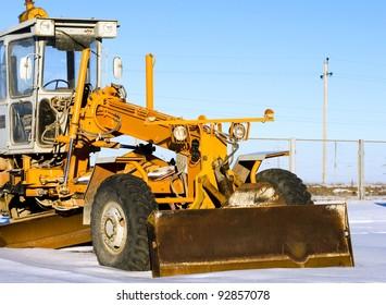 road grader bulldozer on snow