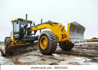 Road grader - heavy earth moving dirty