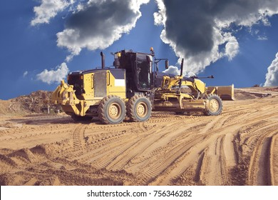 road grader on the sky background