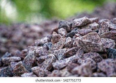 Road gravel and granite gravel texture. Crushed Gravel background. Pile of Stones texture. Industrial coals.