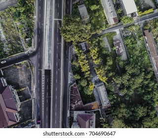 Road in green cityscape in Aerial Photography view
