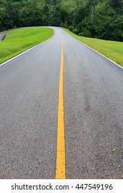 Road with green grass on either side.