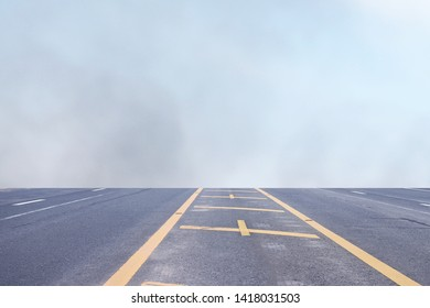 The road and the haze in the morning is suitable for use as a background image.