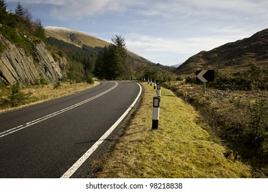 Road in the Highlands of Scotland with no traffic.