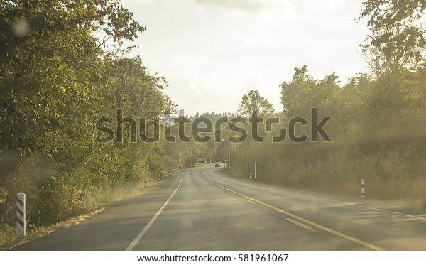 Road Highway around forest Background. Travel in Thailand. Hope concept.