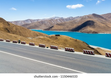 road and holy lake landscape in tibet