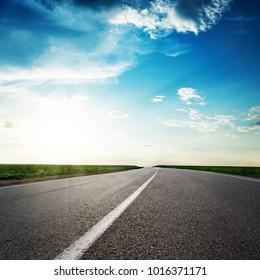 road to horizon in sunset