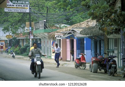 a road with houses at the Village of Las Terrenas on Samana at Dominican Republic in the Caribbean Sea in Latin America.  Dominican Republic, Samana, April, 2006