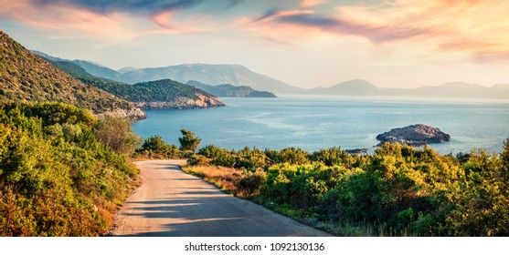 Road to Ierussalim Beach. Picturesque morning seascape of Ionian sea. Impressive sunrise on Kefalonia Island, Greece, Europe. Traveling concept background.