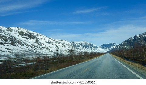 Road into winter landscape with mountains