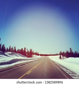 Road in Labrador, spring time with snow