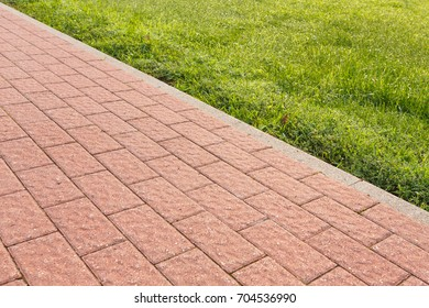 road and lawn divided by a concrete curb