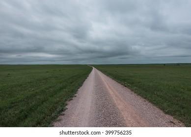 A road leading across the grasslands in Nebraska