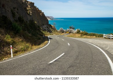 Road leading to a bay. Crystal clear water, amazing landscape. Windy road. Travel, adventure, discover, explore, drive, hike. Sea, ocean, environment, sky.