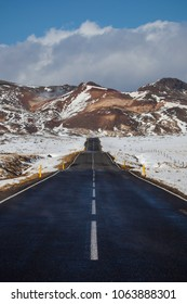 A road leading to geothermal area at Krýsuvík at Reykjanes peninsula in Iceland during winter time.