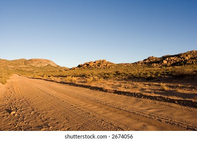 Road leading to granite dome in mountains.