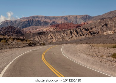 A road leading into a wild wild scenery in Argentina