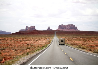 The road leading to Monument Valley, Utah.  A motor home is driving into the iconic scenic area.