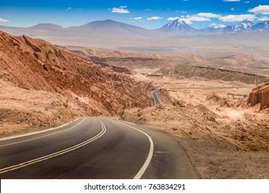Road leading through the arid landscape at the Valley of the Moon in Chile