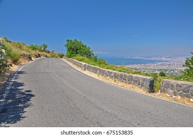 The road leading to the volcano mount Vesuvius and the panorama of the city of Naples, a clear Sunny day